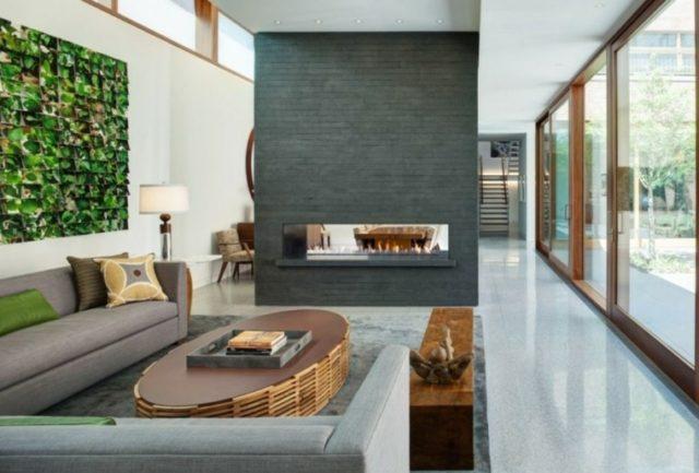 chimeneas-modernas-pared-gris-en-mitad-del-salon