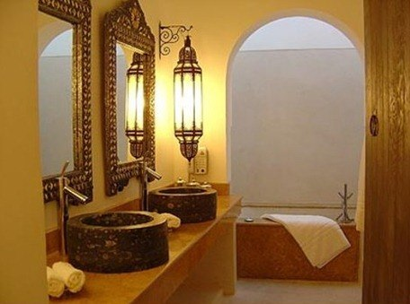 Gorgeous! Love the European faucets, the sinks, traditional mirrors, lanterns, very luxurious.