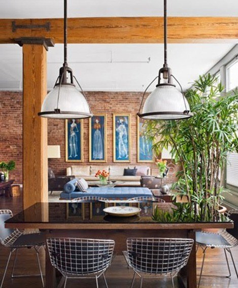 stephan jaklitsch loft exposed brick dining room area dome pendant lights Bertoia chairs wood table exposed brick