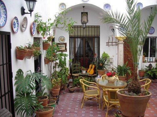 Patio andaluz decoracion for Adornos rusticos para patios