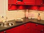 Compact_kitchen_red_painted_corner_solution