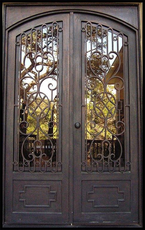 Puertas de hierro forjado for Puertas de metal con diseno