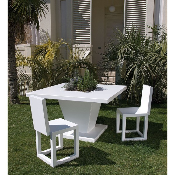 White chairs and garden table