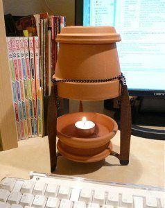 Calentar la casa en invierno con una maceta y una vela por - Calefaccion con velas ...