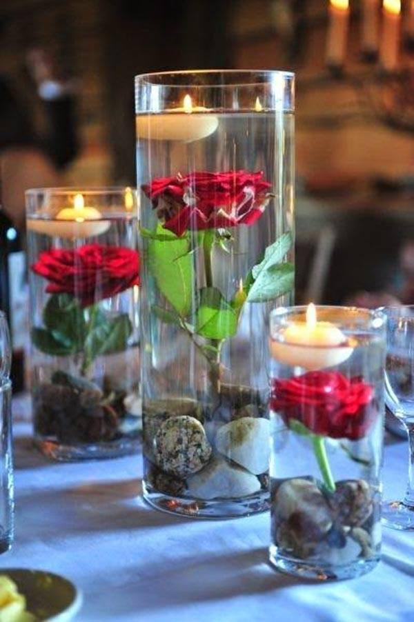 Table-center-with-floating-candles-and-roses