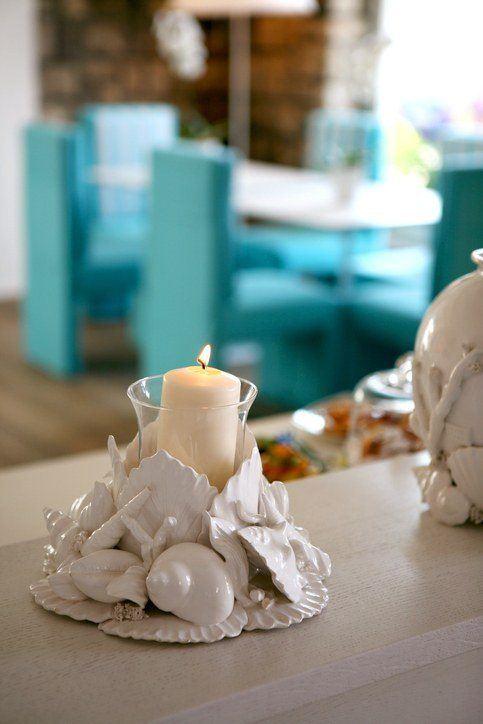 Centros de mesa para bautizos con velas y conchas