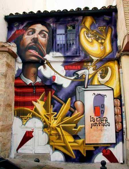 20-fotos-e-ideas-colores-fachadas-casas-exteriores-casa-pintada-de-graffitti