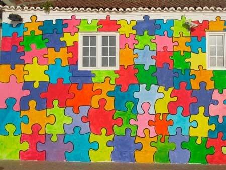 20-fotos-e-ideas-colores-fachadas-casas-exteriores-casa-pintada-de-puzzle