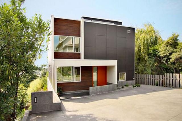 50-fotos-fachadas-casas-mas-bonitas-modernas-del-mundo-casa-de-estilo-futurista-con-puerta-de-color-rojo