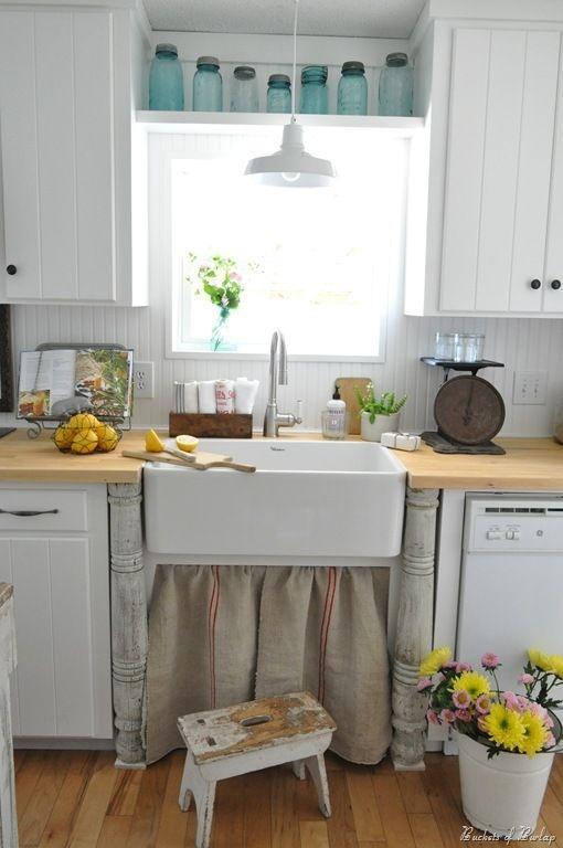 ideas-para-decorar-una-cocina-estilo-vintage-pila-manos