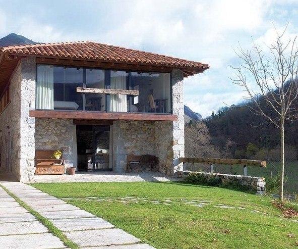 casa-rustica-y-moderna-con-piedras-en-la-fachada