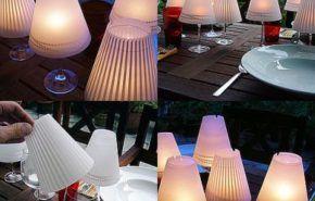 Cómo fabricar centros de mesa con velas y copas de vino