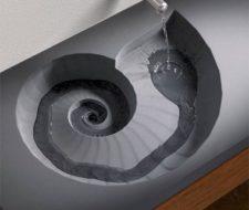 Lavabo de hormigón con forma de caracol