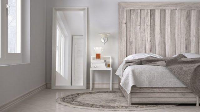 como-decorar-una-pared-con-espejos-dormitorio-istock3