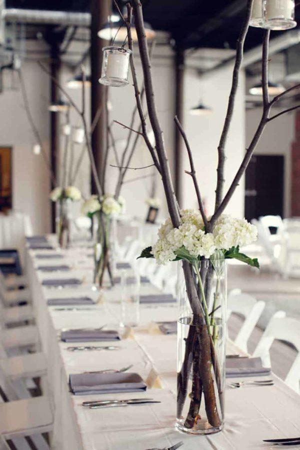 Centro de mesa para boda ramas flores