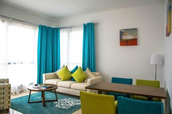 como-decorar-con-paredes-en-verde-agua-salon-decoora