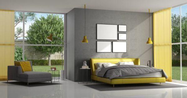 decorar-la-pared-del-dormitorio-cuadros-blanco-istock