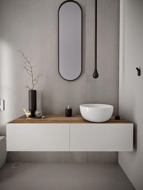 Paredes baño moderno marmol y microcemento