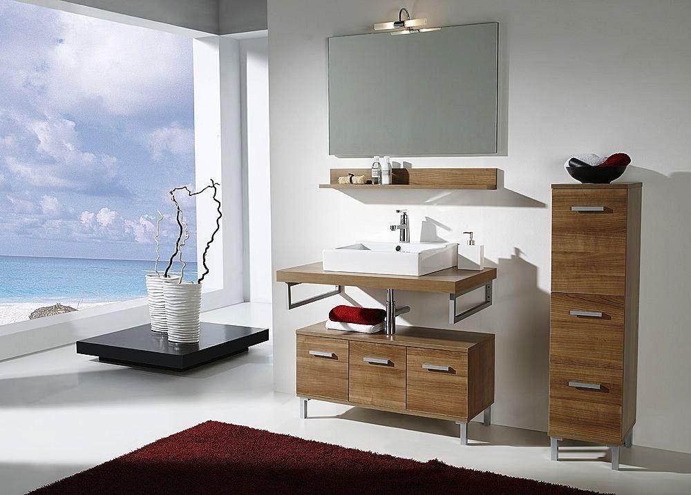 Decorar Un Baño Blanco: un pequeño mueble de madera para guardar las toallas, o un botiquín